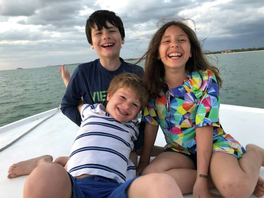 The kids on the sunset cruise: Louis, 10; Selma, 8; and George, 7. Photo: Claire Tisne Haft
