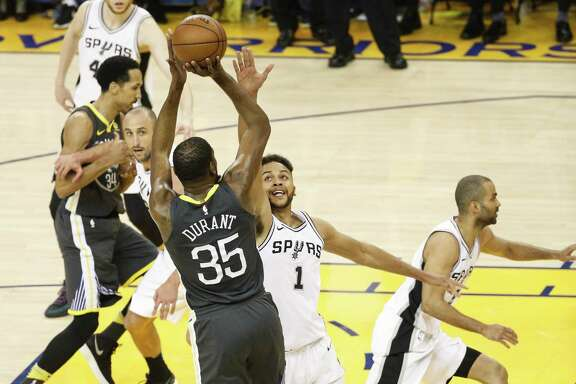 San Antonio Spurs' Kyle Anderson tries to defend against Golden State Warriors' Kevin Durant in the second quarter during game 2 of round 1 of the Western Conference Finals at Oracle Arena on Monday, April 16, 2018 in Oakland, Calif.