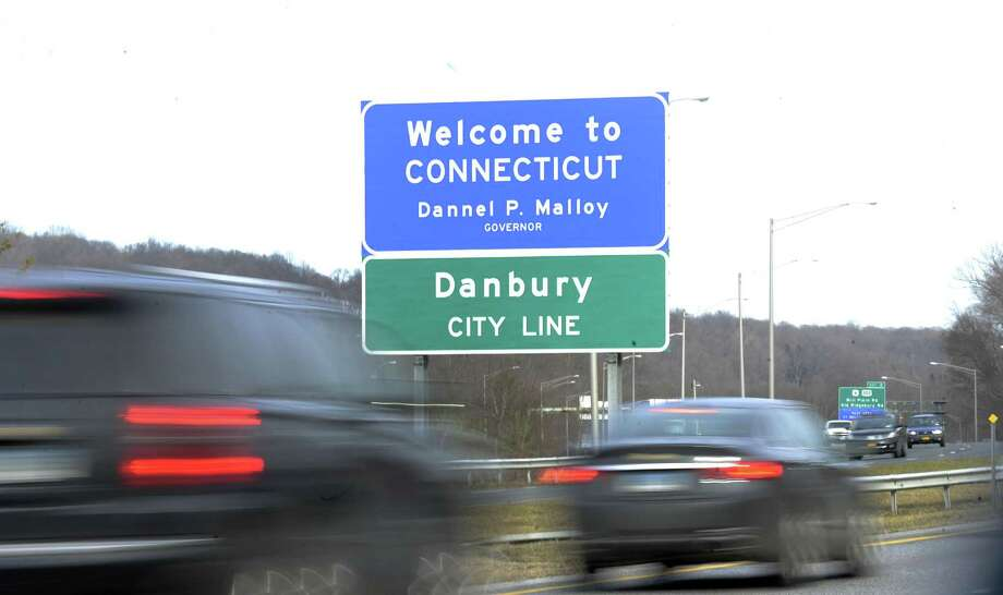 The Welcome to Connecticut signs appears above the Danbury city line sign on I-84 East on the New York Connecticut border Monday, Feb. 27, 2017. Photo: Carol Kaliff / Hearst Connecticut Media / The News-Times