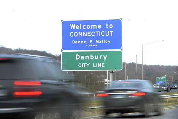 The Welcome to Connecticut signs appears above the Danbury city line sign on I-84 East on the New York Connecticut border Monday, Feb. 27, 2017.