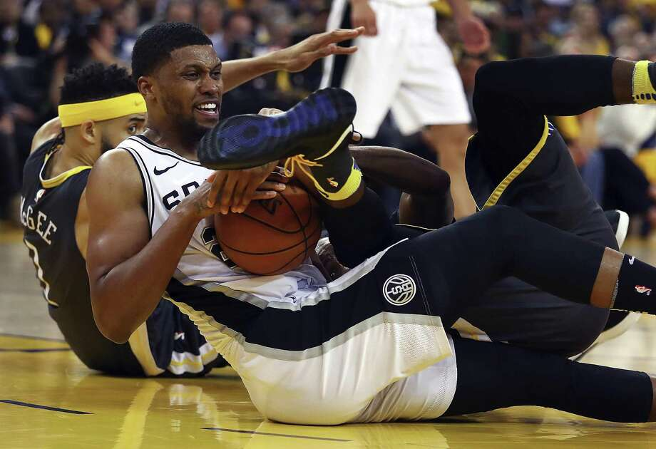 San Antonio Spurs' Rudy Gay hangs on to the ball as Golden State Warriors' Draymond Green rolls over him during the second half in Game 2 of a first-round NBA basketball playoff series, Monday, April 16, 2018, in Oakland, Calif. Golden State won 116-101. (AP Photo/Ben Margot) Photo: Ben Margot, STF / Associated Press / Copyright 2018 The Associated Press. All rights reserved.