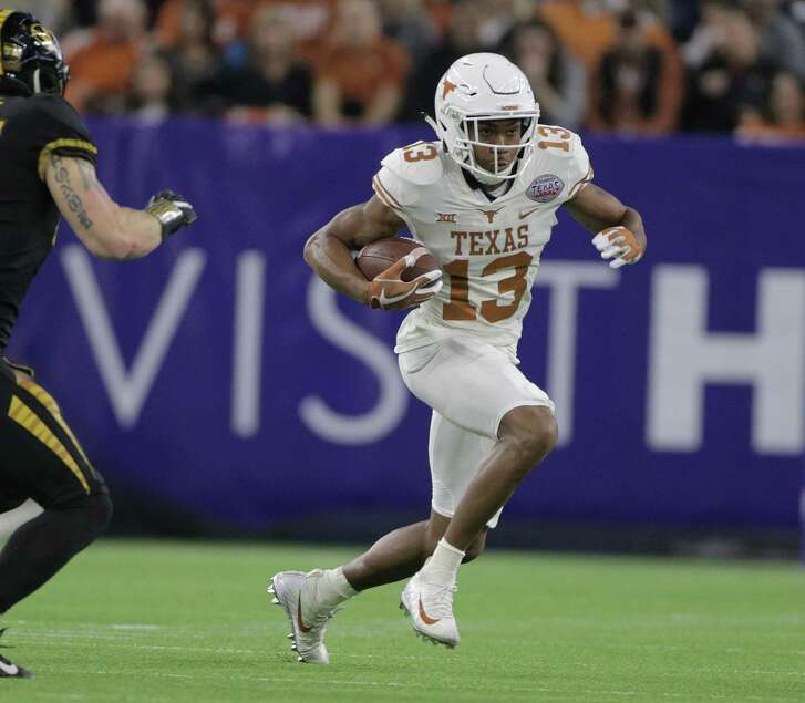 Texas Longhorns wide receiver Jerrod Heard (13) runsin the first quarter of the The Academy Sports + Outdoors Texas Bowl between against Missouri at NRG Stadium on Wednesday, Dec. 27, 2017, in Houston. ( Elizabeth Conley / Houston Chronicle )