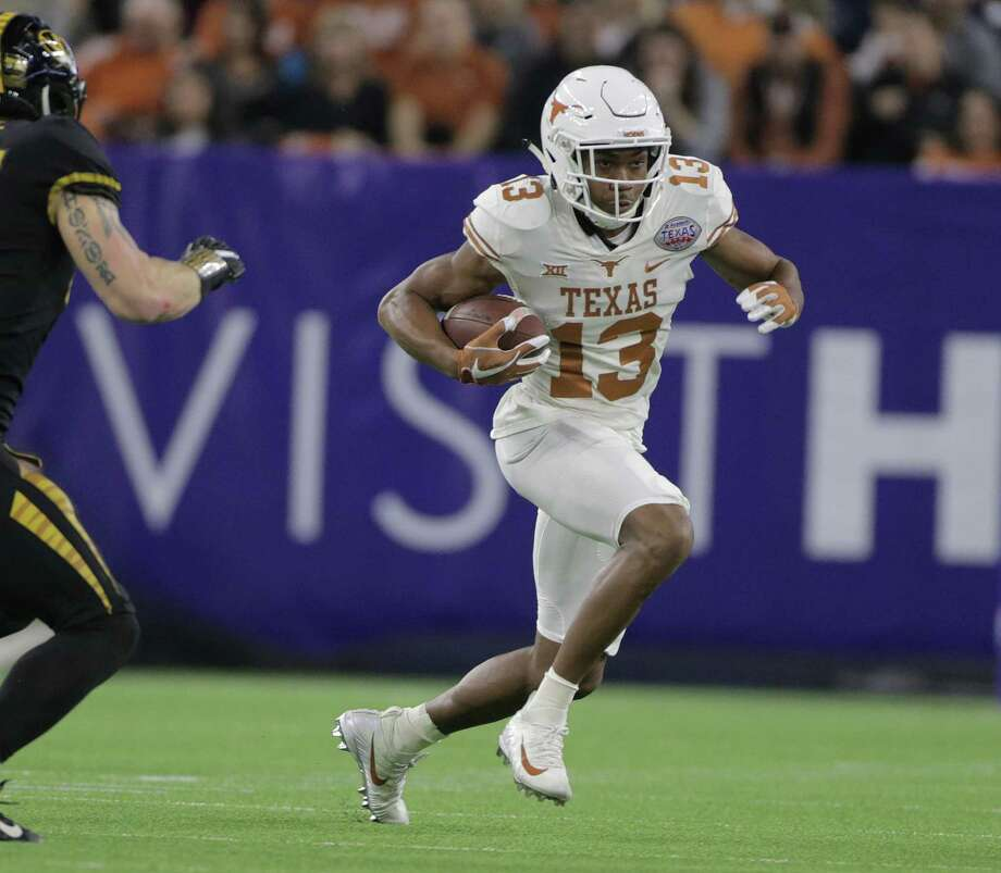 Texas Longhorns wide receiver Jerrod Heard (13) runsin the first quarter of the The Academy Sports + Outdoors Texas Bowl between against Missouri at NRG Stadium on Wednesday, Dec. 27, 2017, in Houston. ( Elizabeth Conley / Houston Chronicle ) Photo: Elizabeth Conley, Chronicle / Houston Chronicle / © 2017 Houston Chronicle