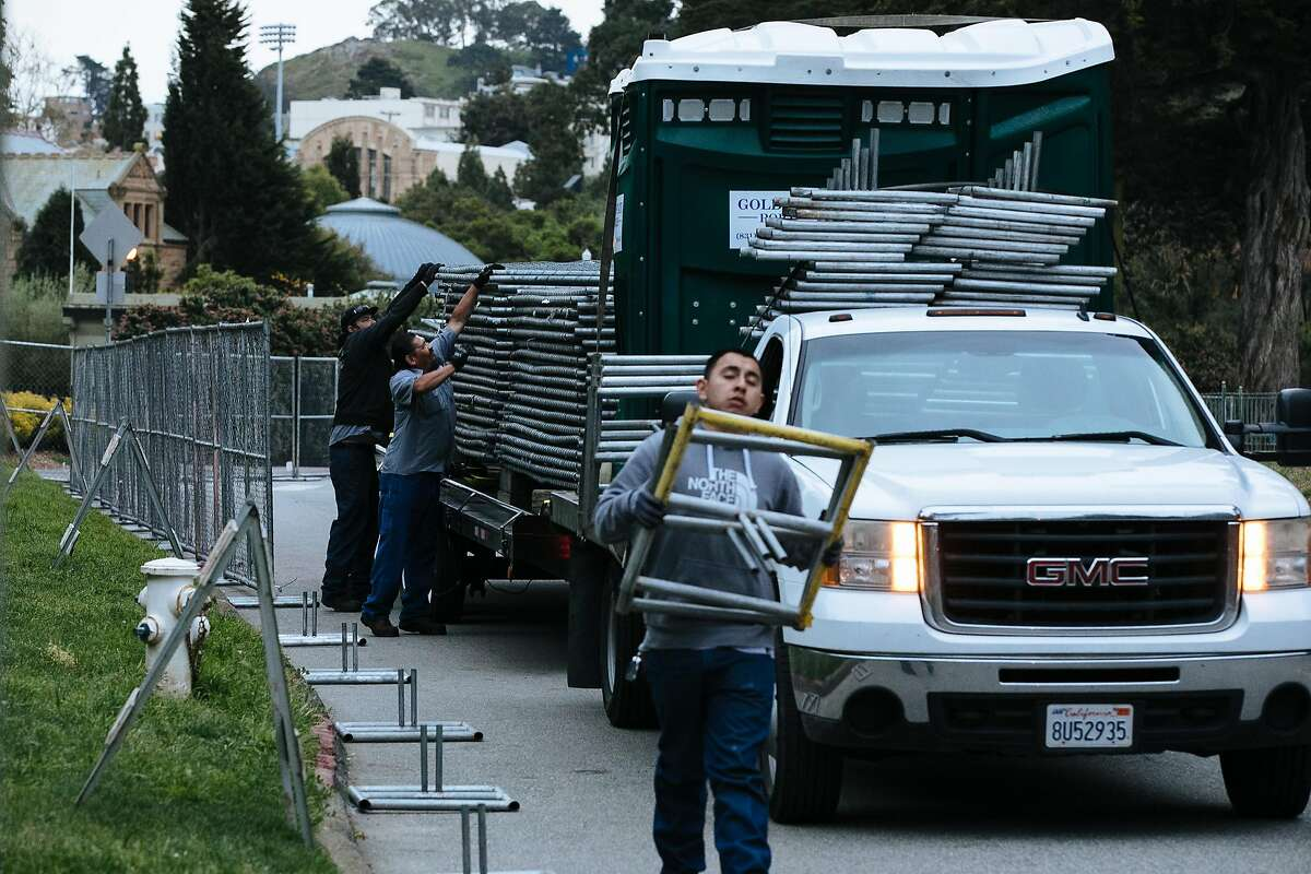 Crew begin to installs fencing on Bowling Green Drive in preparation for this weekend's annual 420 celebration at Golden Gate Park.