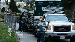 Crew begin to installs fencing on Bowling Green Drive in preparation for this weekends annual 4/20 celebration at the Golden Gate Park in San Francisco, Calif., Tuesday, April 17, 2018.