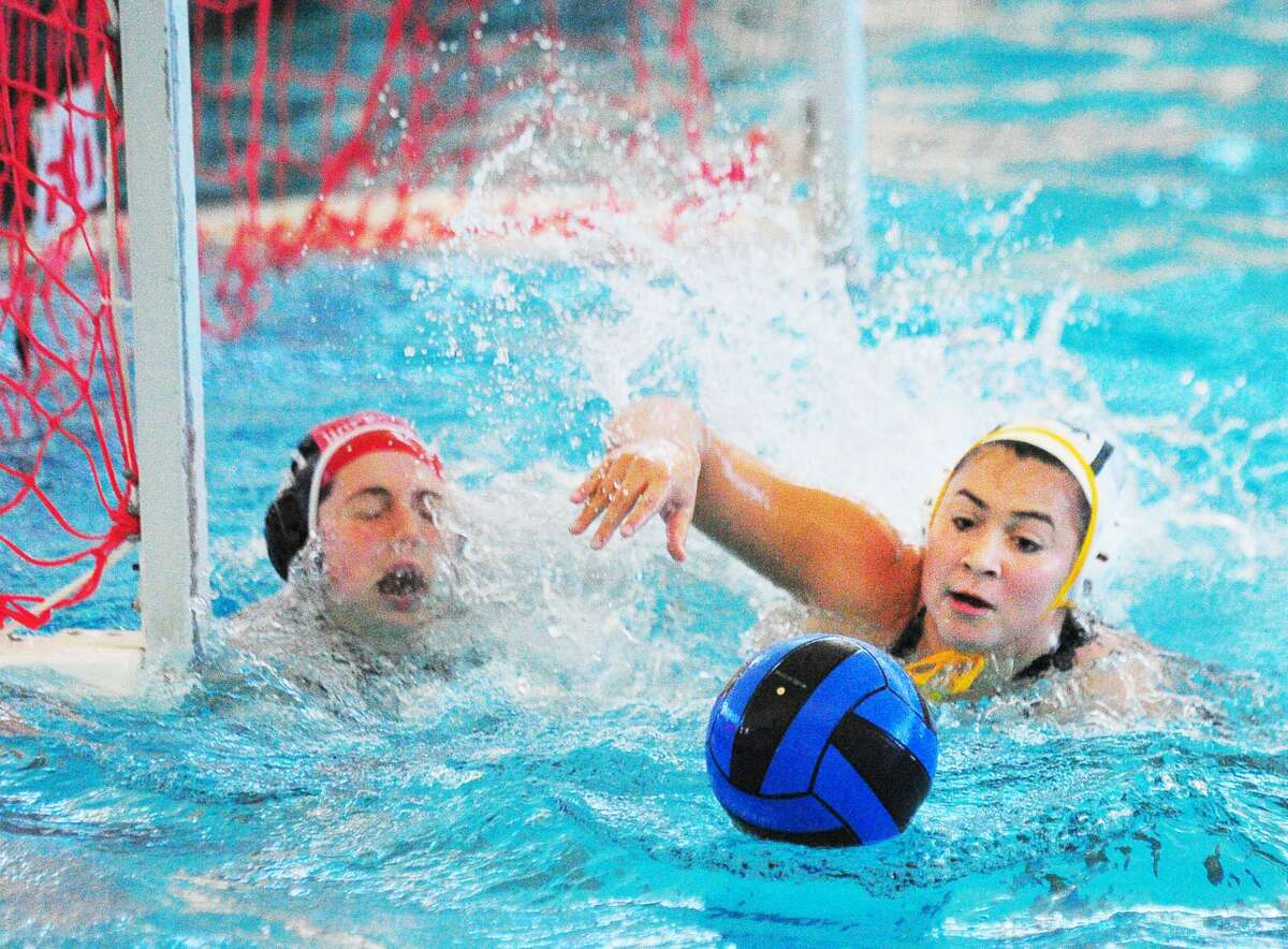 Greenwich Academy's Kayla Yelensky, right, goes for a loose ball as does Hopkins goalie Georgia Doolittle during their match at the YMCA of Greenwich on Wednesday. Yelensky scored on the play.