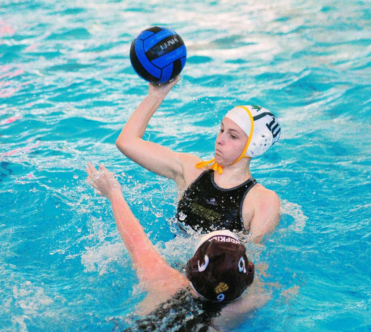 Camille Daigle, top, of Greenwich Academy passes the ball as Emelia Aniskovich of Hopkins School defends on Wednesday.
