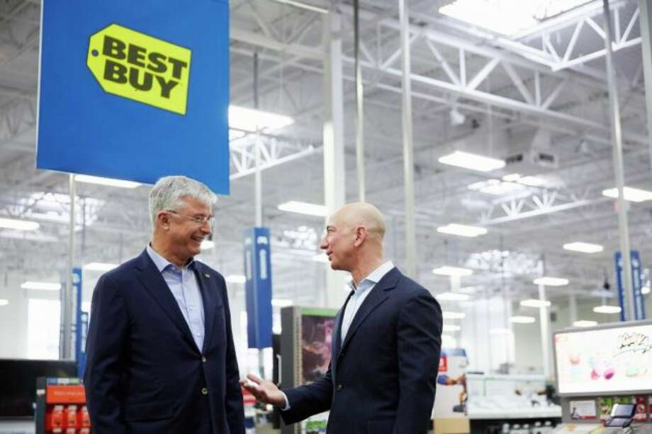 Best Buy CEO Hubert Joly with Amazon CEO Jeff Bezos.