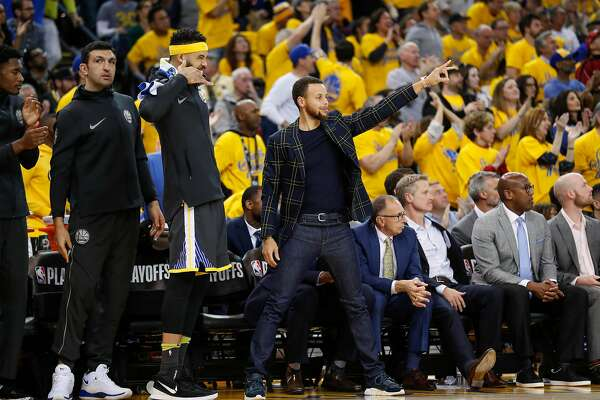 Golden State Warriors' JaVale McGee and Stephen Curry react in the fourth quarter during game 2 of round 1 of the Western Conference Finals at Oracle Arena on Monday, April 16, 2018 in Oakland, Calif.