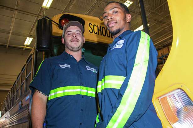 Humble ISD Technician Jerrod Jacobs (left) and Shop Helper Jovan Jackson (right) placed first and third place in the 2018 TASBT School Bus Technician Texas' Best Competition.