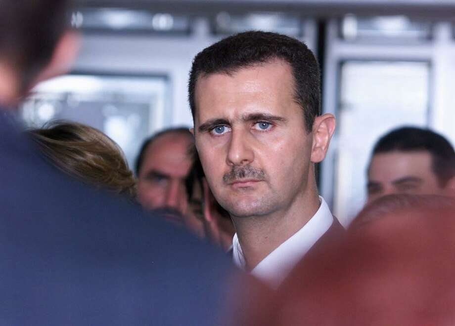 An attack on Syria to punish it for use of chemical weapons does not constitute policy. The end game should be arming rebels to force Syrian President Bashar Assad, shown here, to the negotiating table to achieve a coalition government that doesn't include him. Photo: Jack Guezjack GuezAFP /Getty Images