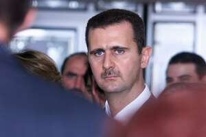 An attack on Syria to punish it for use of chemical weapons does not constitute policy. The end game should be arming rebels to force Syrian President Bashar Assad, shown here, to the negotiating table to achieve a coalition government that doesn't include him.