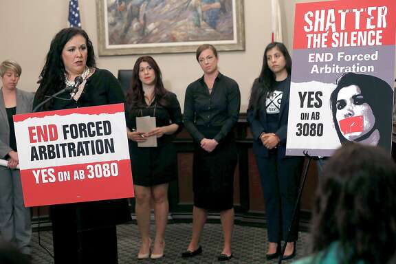 Assemblywoman Lorena Gonzalez Fletchert (left) speaks at a press conference at the State Capitol on Wednesday, April 18. 2018, in Sacramento, Calif.  Seeking to free sexual harassment victims from forced arbitration agreements, the state Assembly is voting to subpoena victims to testify in open session.