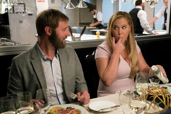 Amy Schumer, next to Rory Scovel, plays a woman who wakes up changed after a head injury. MUST CREDIT: Mark Schäfer, STX Films