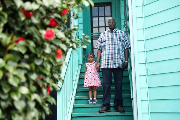 Dante Zedd and his daughter Addie, 5, pose on the steps of Dante's mother's house in the Dogtown neighborhood of Oakland, Calif., on Sunday, April 15, 2018.