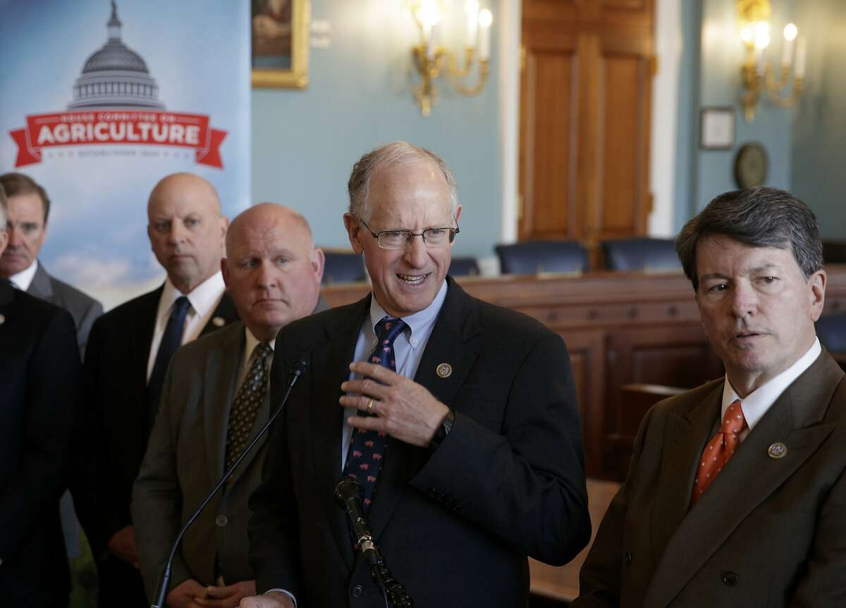 House Agriculture Committee Chairman Mike Conaway, R-Texas, center, joined from left by Rep. Neal Dunn, R-Fla., Rep. Scott DesJarlais, R-Tenn., Vice-Chairman Glenn Thompson, R-Pa., and Rep. John Faso, R-N.Y., discusses the farm bill, officially known as the 2018 Agriculture and Nutrition Act, at a news conference on Capitol Hill in Washington, Thursday, April 12, 2018. The bulk of the bill's spending goes toward funding SNAP, the Supplemental Nutrition Assistance Program. (AP Photo/J. Scott Applewhite)