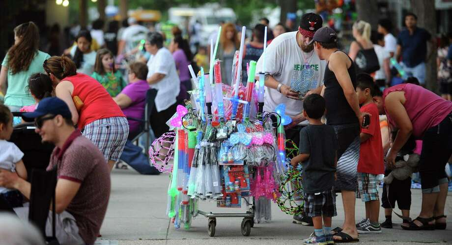 FILE PHOTO: A vendor sells light up toys as resident flock to the annual fireworks spectacular at Cummings Park and Beach on Thursday, June 30, 2017 in Stamford, Connecticut. Photo: Matthew Brown / Hearst Connecticut Media / Stamford Advocate