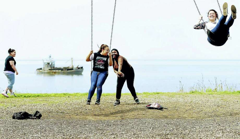 Eli Whitney Technical High School of Hamden students Diangelita Valle, 17, Gloria Huerta, 18, Shonea Sherard, 16, and Brianna Colon, 15, left to right, enjoy abreak on the swings at Fort Hale Park in New Haven as the four students, classmates and teachers participate in a planned clean-up and giving back to the community during the school's first Community Service Day in May 2016. Photo: Peter Hvizdak / Hearst Connecticut Media File Photo / ©2016 Peter Hvizdak