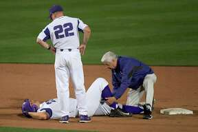 TCU first baseman Luken Baker (19) lies on the field after injuring his ankle on a slide into second base during the seventh inning against Abilene Christian during an NCAA college baseball game in Fort Worth, Texas, Tuesday, April 17, 2018. (Max Faulkner/Star-Telegram via AP)