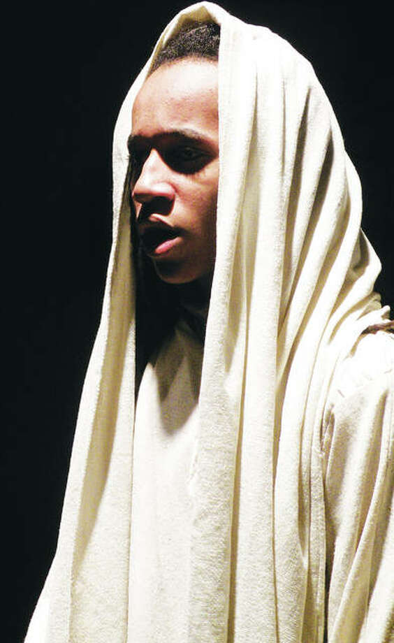 """Micah Showers as Jesus in Marquette Catholic High School's production of """"Jesus Christ Superstar."""" Photo:       For The Telegraph"""