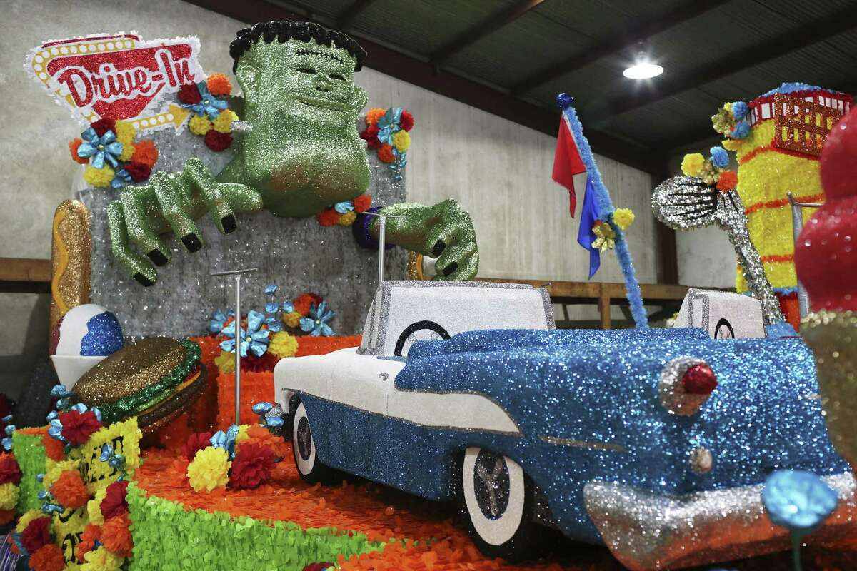 """A movie drive-in theatre themed float features two Oldsmobile Rocket 88 convertibles, Wednesday, April 18, 2018. This float is part of the Battle of Flowers public school floats with this year?•s theme, ?'Treasured Pleasures.?"""" The nine floats feature iconic San Antonio scene such as the Brackenridge Park, miniature golf and the movie drive-in. Each floats features students from San Antonio area high schools."""