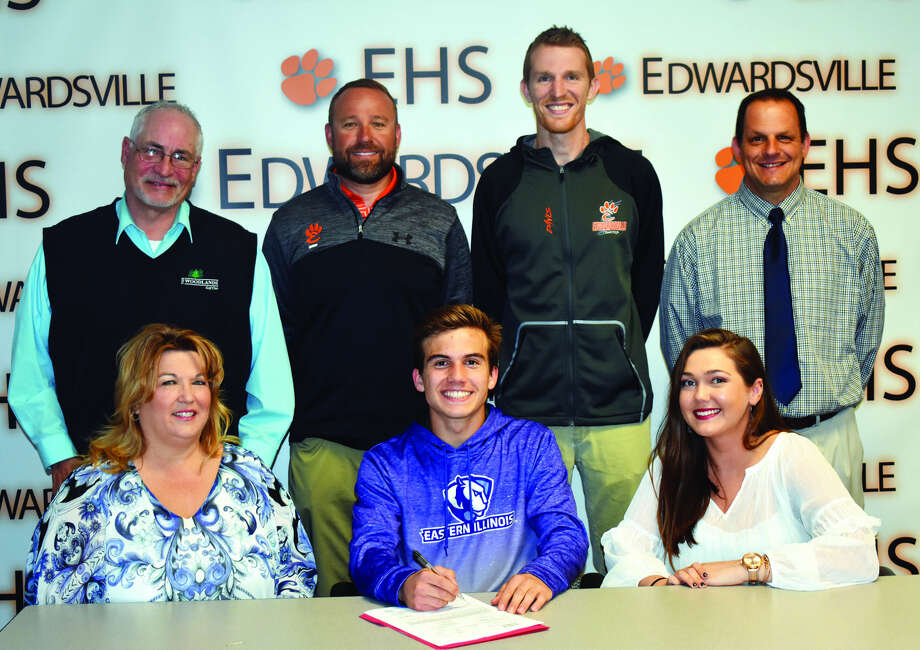 EHS senior Francesco Romano, seated center, will run cross country and track at Eastern Illinois University in Charleston. Seated from left to right are Suzanne Gaudette, mother, Francesco, and Daniella Romano, sister. Standing from left to right are David Gaudette, step father, EHS track and field coach Chad Lakatos, EHS assistant coach Dustin Davis and EHS cross country coach George Patrylak.