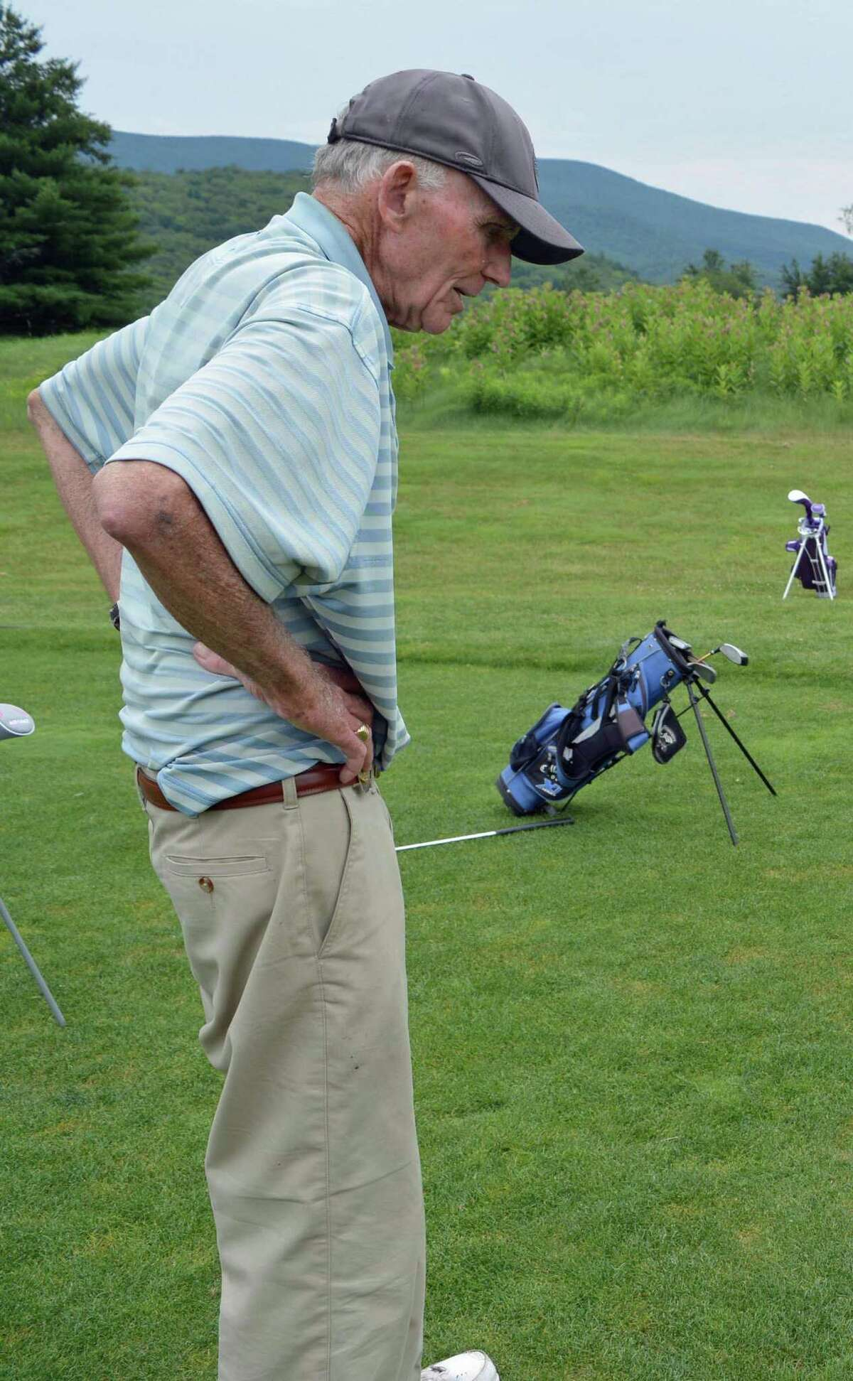 Peter French watches a student swing a golf club at a clinic for kids he taught at Waubeeka Golf Links in Williamstown, Mass. on Sunday, June 23, 2017 in this photograph provided by The Berkshire Eagle.