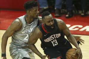 Minnesota Timberwolves guard Jimmy Butler (23) tries to strip the ball from Houston Rockets guard James Harden (13) during the fourth quarter of Game 1 of an NBA basketball first-round playoff series at Toyota Center on Sunday, April 15, 2018, in Houston. ( Yi-Chin Lee / Houston Chronicle )
