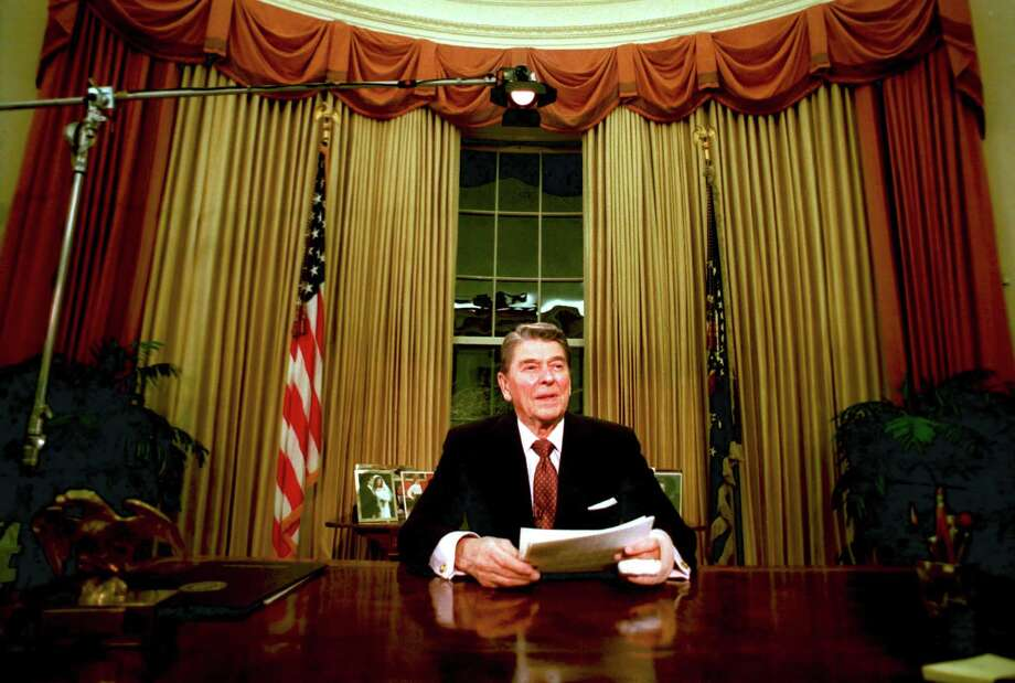 Departing U.S. President Ronald Reagan is seen shortly after he delivered his farewell address to the nation at the Oval Office in the White House on Jan. 12, 1989. Photo: RON EDMONDS, STF / AP / AP
