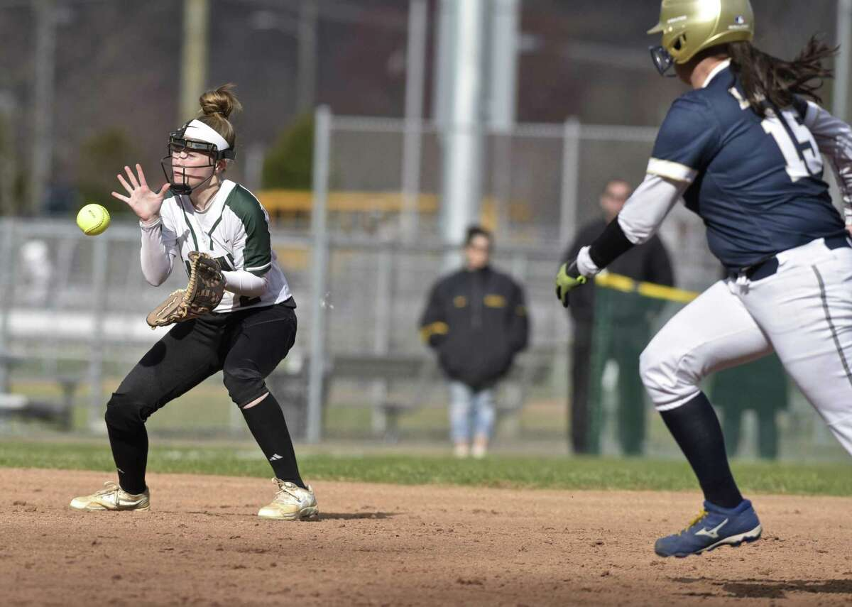 New Milford's Sarah Mickelson (2) looks at a hard hit ball as Notre Dame's Meredith McDonald (15) takes off from second base in the girls softball game between Notre Dame - Fairfield and New Milford high schools, Wednesday afternoon, April 18, 2018, at New Milford High School, New Milford, Conn.