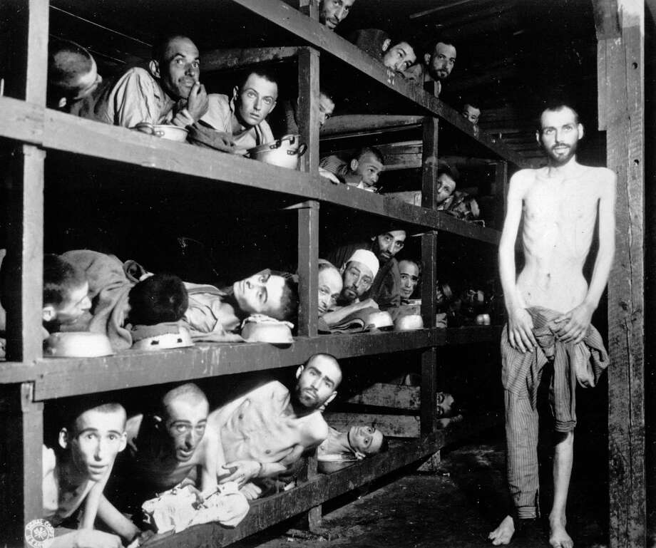 A photo provided by the U.S. Army, taken April 16, 1945, of people in the Buchenwald concentration camp, including Elie Wiesel, seventh from left in the middle bunk, who went on to win the Nobel Peace Prize. A new survey found that many Americans lack basic knowledge of the Holocaust -- especially 18 to 34-year-olds, or so-called millenials. (United States Army via The New York Times) Photo: UNITED STATES ARMY / UNITED STATES ARMY