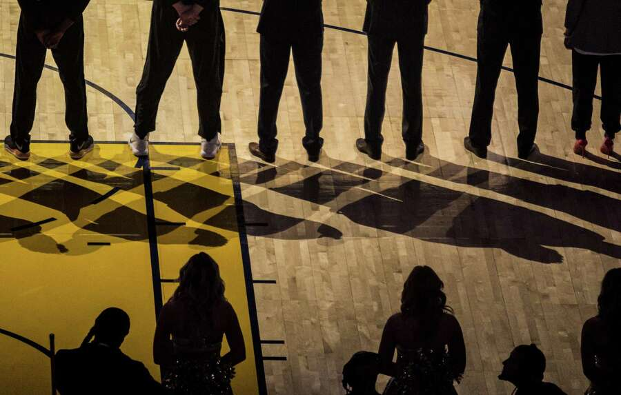 The San Antonio Spurs line up during the opening ceremony as the Golden State Warriors and San Antonio Spurs face off during the second game of the NBA Playoffs at Oracle Arena in Oakland on Monday, April 16, 2018. Photo: Jessica Christian / The Chronicle / ONLINE_YES