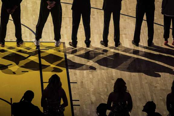 The San Antonio Spurs line up during the opening ceremony as the Golden State Warriors and San Antonio Spurs face off during the second game of the NBA Playoffs at Oracle Arena in Oakland on Monday, April 16, 2018.