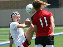 Jasper's Kylee Dominy battles for the ball with a Kilgore defender during Wednesday's Class 4A state semifinal game at Birkelbach Field in Georgetown. The Lady Dawgs won and will play Midlothian Heritage for the state title at 2:30 p.m. today. (Jason Dunn/Special to The Enterprise)
