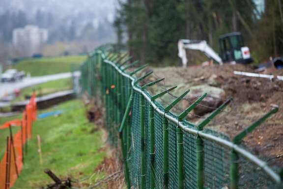 Barbed wire fencing stands at the Kinder Morgan Inc. Trans Mountain pipeline expansion site in Burnaby, British Columbia, Canada, on Wednesday, April 11, 2018. Alberta, the landlocked Canadian province that's home to the oil sands, would be willing to buy out Kinder Morgan's Trans Mountain pipeline if that's the only way to salvage the critical export route, Premier Rachel Notley said. Photographer: Ben Nelms/Bloomberg