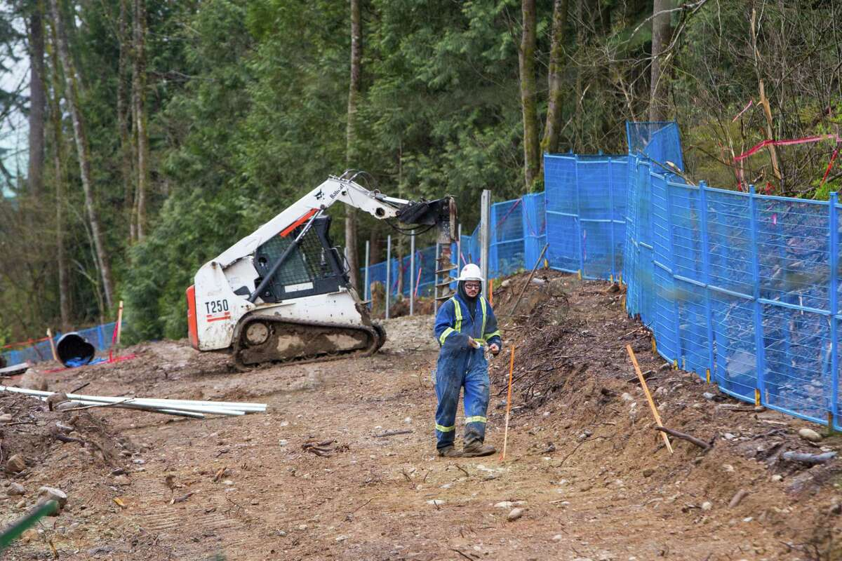 A contractor works at the Kinder Morgan Inc. Trans Mountain pipeline expansion site in Burnaby, British Columbia, Canada, on Wednesday, April 11, 2018. Alberta, the landlocked Canadian province that's home to the oil sands, would be willing to buy out Kinder Morgan's Trans Mountain pipeline if that's the only way to salvage the critical export route, Premier Rachel Notley said. Photographer: Ben Nelms/Bloomberg
