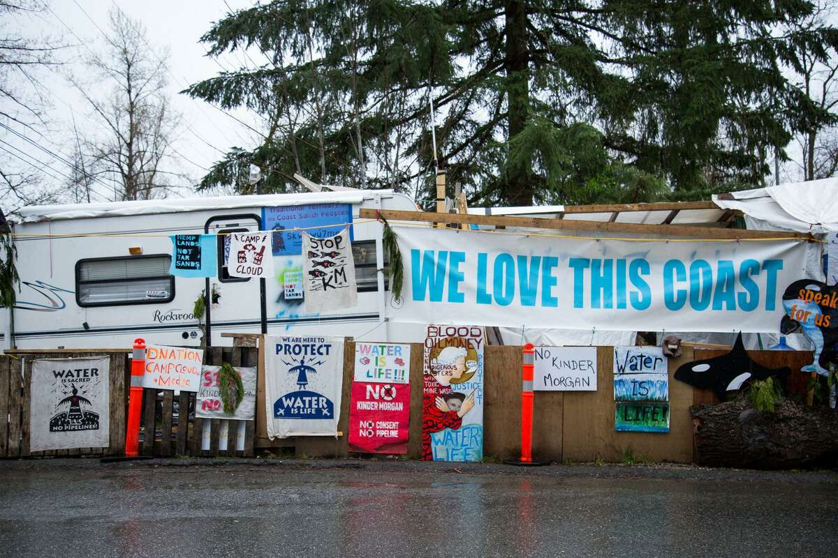 Protest signs are displayed outside of the Kinder Morgan facility in Burnaby, British Columbia, Canada, in April . MUST CREDIT: Bloomberg photo by Ben Nelms.