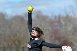 Starting pitcher Gillian Kane (5) of the New Canaan Rams delivers a pitch during a game against the Stamford Black Knights at Waveny Park on Wednesday April 18, 2018, in New Canaan, Connecticut.