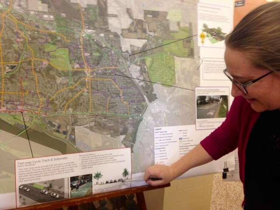 "President Mary Vandevord of HeartLands Conservancy explains elements in a legend on a satellite map of proposed improvements in the draft, 20-year, Alton ""Pedestrian and Bicycle Master Plan"" during an open house Tuesday at Alton City Hall. Photo:       Linda N. Weller 