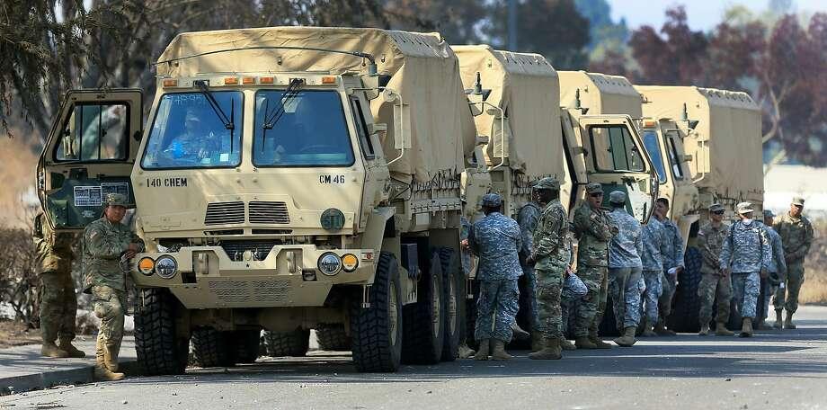 California National Guard troops near Santa Rosa in October. Photo: Kent Porter / Associated Press