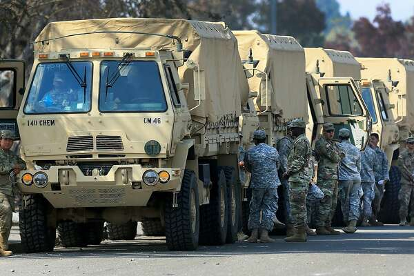 "This Oct. 16, 2017,  photo shows the California National Guard deployed near Santa Rosa, Calif. President Donald Trump slammed California Gov. Jerry Brown's posture on sending National Guard troops to the Mexican border Tuesday, April 17, 2018, even as Brown said he was nearing agreement on joining the president's mission and that his troops were ""chomping at the bit ready to go."" (Kent Porter/The Press Democrat via AP)"