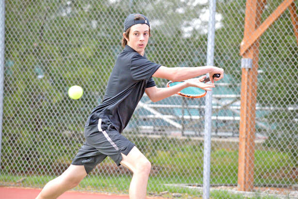 Edwardsville junior Drake Schreiber makes a backhand return during his No. 3 singles match against Collinsville on Wednesday at the EHS Tennis Center.