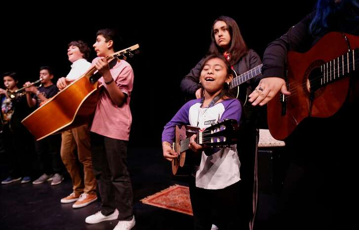 Members of the Mariachi band, including Gina Gonzalez, 7 perform during rehearsals on Wed. April 11, 2018, at the Brava Theater in San Francisco, Ca.  The Brava Theater teams up with Mission Academy of Performing arts to present Between Dirt & Sky,  an original musical performed by young actors.