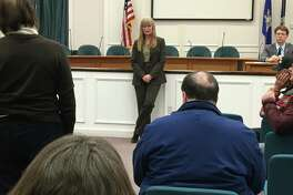 West Haven Mayor Nancy Rossi, center, meets with residents at her first town hall meeting Tuesday night in City Hall.