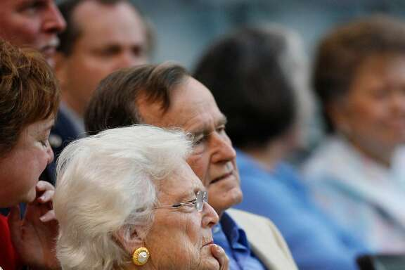 Former first lady Barbara Bush and George settle into the diamond club seats during the 1st inning of the Houston Astros-St. Louis Cardinals'  MLB baseball game at Minute Maid Park, Thursday, May 4, 2006.  (Karen Warren / Houston Chronicle)