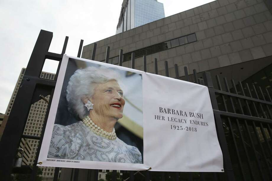 A tribute banner dedicated to former First Lady Barbara Pierce Bush is up on the gate of the Houston Public Library and Barbara Bush Literacy Plaza on Wednesday, April 18, 2018, in downtown Houston. Mrs. Bush passed away Tuesday at her Post Oak home. She was 92. ( Yi-Chin Lee / Houston Chronicle ) Photo: Yi-Chin Lee / Houston Chronicle / © 2018 Houston Chronicle
