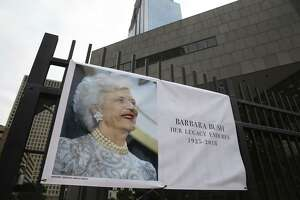 A tribute banner dedicated to former First Lady Barbara Pierce Bush is up on the gate of the Houston Public Library and Barbara Bush Literacy Plaza on Wednesday, April 18, 2018, in downtown Houston. Mrs. Bush passed away Tuesday at her Post Oak home. She was 92. ( Yi-Chin Lee / Houston Chronicle )