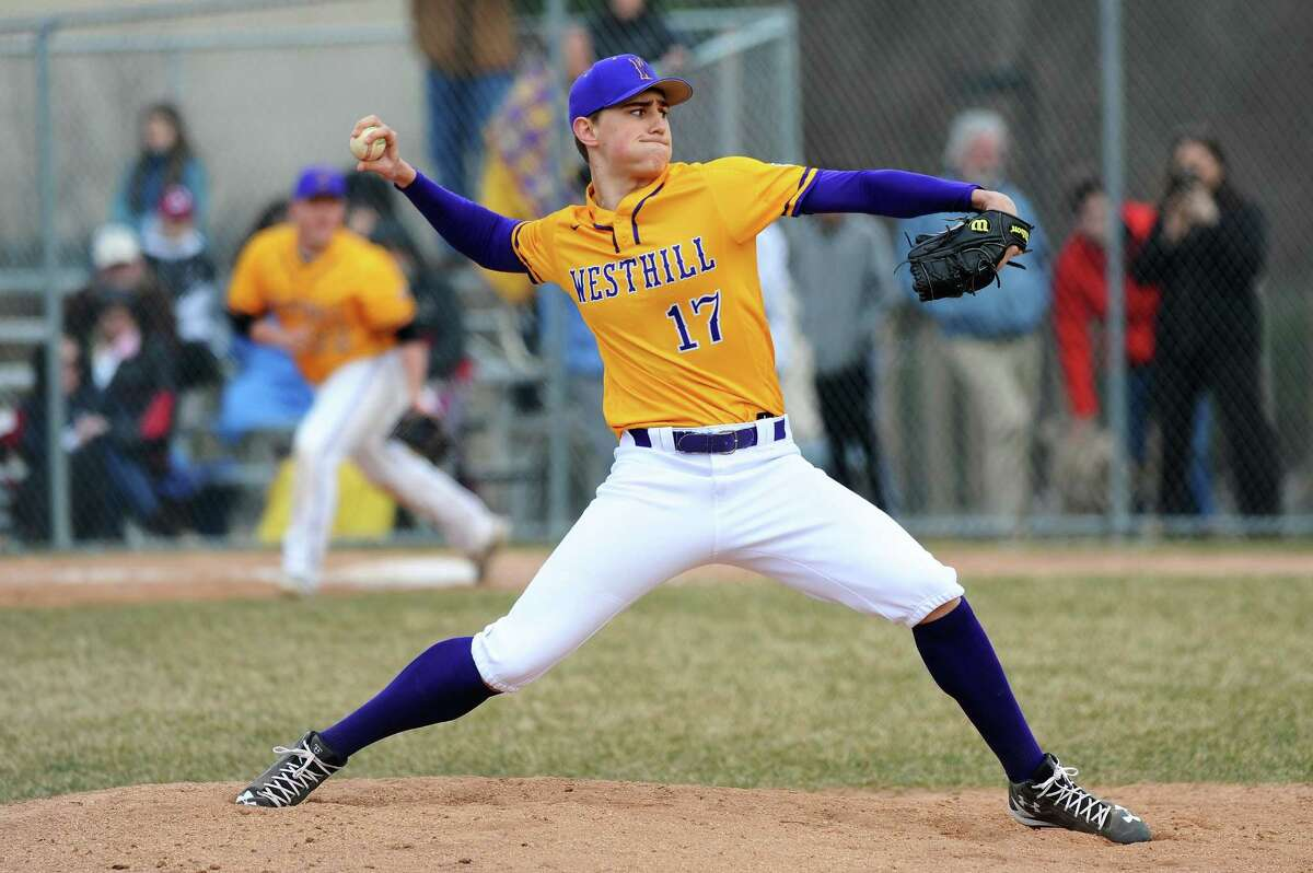 Westhill High School senior John MacDonald throws a pitch during a varsity baseball game against Wilton High School at Westhill's Viking Field in Stamford, Conn. on Monday, April 9, 2018. MacDonald threw a complete game and gave up two earned runs.