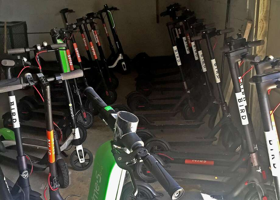 Confiscated scooters are seen at a San Francisco Department of Public Works storage facility on Friday, April 13, 2018 in San Francisco, Calif. Photo: Courtesy San Francisco Department Of Public Works