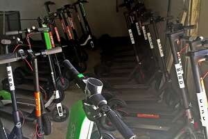 Confiscated scooters are seen at a San Francisco Department of Public Works storage facility on Friday, April 13, 2018 in San Francisco, Calif.